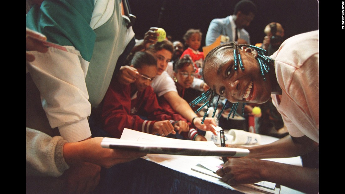 Venus signs autographs after winning her professional debut in October 1994. She was 14 years old when she defeated Shaun Stafford at the Bank of the West Classic in Oakland, California.