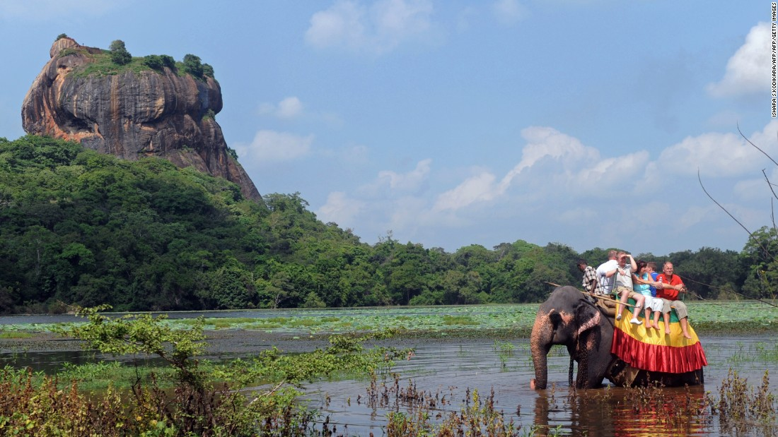 Foreign tourists ride an elephant during a sightseeing tour in the ancient city of Sigiriya -- or Lion Rock -- in Sri Lanka.