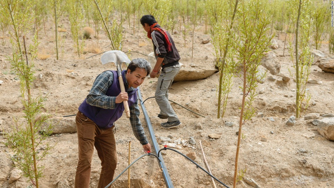 Sonam Wangchuk and a colleague create a drip irrigation network to use water from ice stupas.