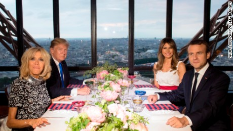 French President Emmanuel Macron (R), his wife Brigitte Macron (L), US President Donald Trump (2nd L) and First Lady Melania Trump (2nd R) attend a dinner at Le Jules Verne Restaurant on the Eiffel Tower in Paris, on July 13, 2017 as part of US president's 24-hour trip that coincides with France's national day and the 100th anniversary of US involvement in World War I. AFP PHOTO / SAUL LOEB