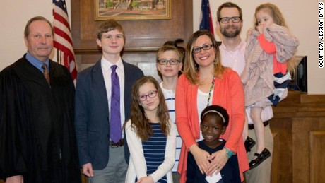 """The Davises in court the day an Ohio judge made Mata's adoption official. Mata bonded with her new siblings quickly, Jessica says: """"They were playing tag; they were doing bubbles. ... It was amazing."""""""