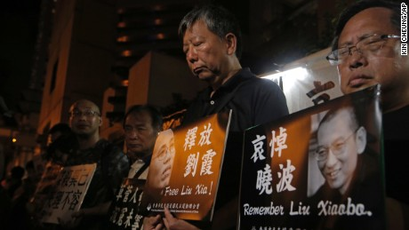 Protesters mourn jailed the death of Chinese Nobel Peace laureate Liu Xiaobo during a demonstration in Hong Kong on 13 July 13.