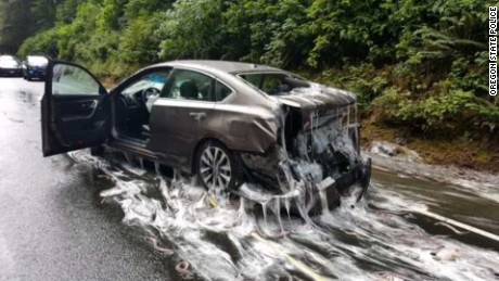 One of the cars in the four-vehicle pile up is seen covered with eels secreting a white slime.