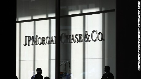 NEW YORK, NY - OCTOBER 02:  People pass a sign for JPMorgan Chase & Co. at it's headquarters in Manhattan on October 2, 2012 in New York City. New York Attorney General Eric Schneiderman has filed a civil lawsuit against JPMorgan Chase alleging widespread fraud in the way that mortgages were packaged and sold to investors in the days that lead-up to the financial crisis. The allegations, which were filed in New York State Supreme Court, concern business that transpired during 2006 and 2007 at a now-defunct Bear Stearns, the failed Wall Street firm which was purchased in 2008 by JPMorgan Chase.  (Photo by Spencer Platt/Getty Images)