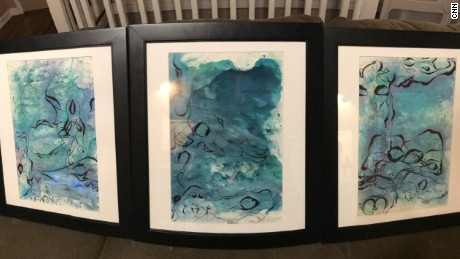 Nadia's paintings were framed and displayed at her high school.