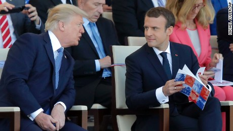 U.S. President Donald Trump, left, discusses with French President Emmanuel Macron prior to the traditional Bastille Day military parade on the Champs Elysees, in Paris, Friday, July 14, 2017. (AP Photo/Michel Euler)