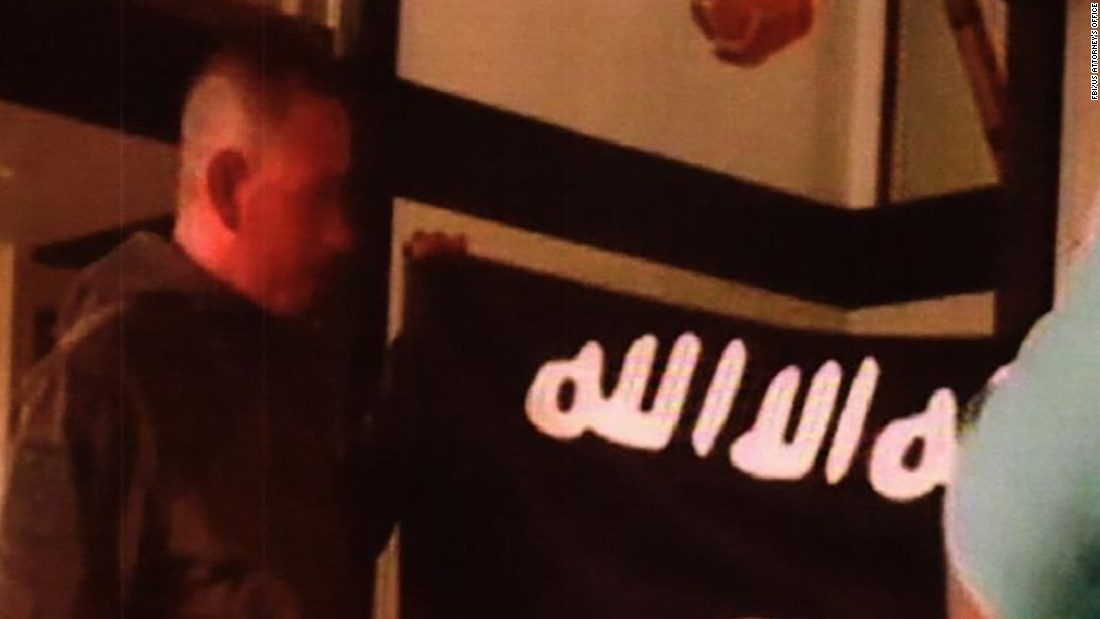 Photos show arrested soldier kissing ISIS flag