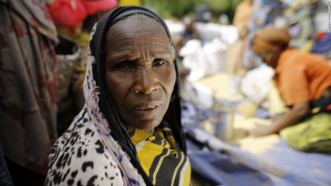 "At a CARE distribution center in Ethiopia, 60-year-old Kediya Shekeleh collects her monthly rations of split peas, wheat and oil. ""This has been the worst drought I have seen in my lifetime,"" she says."