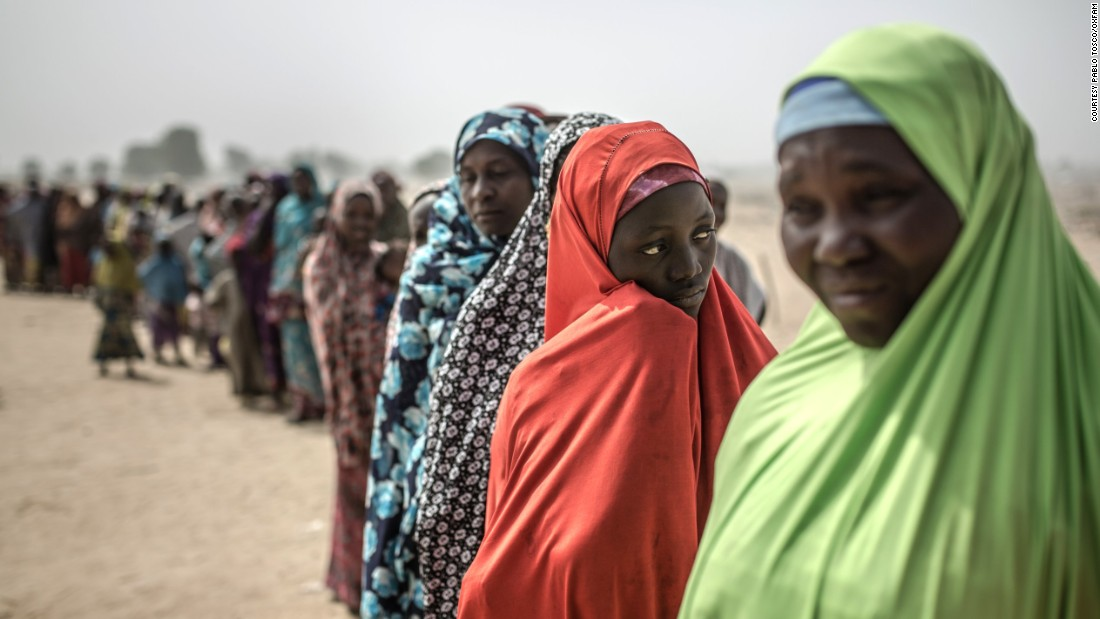 Women gather at the entrance to a camp in northeast Nigeria where more than 30,000 people have sought refuge from the violence of Boko Haram.