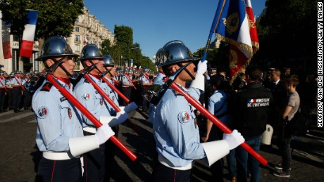 French firefighters prepare to take part in the annual Bastille Day military parade on the Champs-Elysees avenue in Paris on July 14, 2017. / AFP PHOTO / GEOFFROY VAN DER HASSELT        (Photo credit should read GEOFFROY VAN DER HASSELT/AFP/Getty Images)