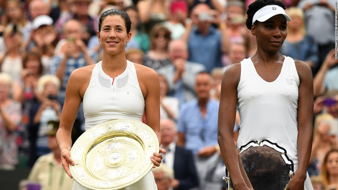Spain's Garbine Muguruza celebrates her Wimbledon final victory after beating Venus Williams 7-5 6-0. This was the second gram slam final of the season Williams has reached. She was beaten by her sister Serena in the Australian Open in January.