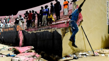 A wall collapsed at Demba Diop Stadium in Dakar after clashes broke out between football fans.