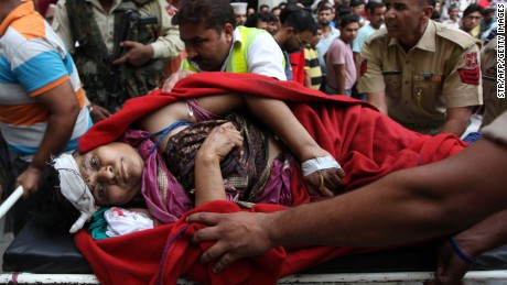 An Indian pilgrim injured in a bus crash is carried on strecther into the government medical college in Jammu on July 16, 2017. At least 16 Hindu pilgrims were killed and many more injured July 16 in a bus crash in northern India, police said, just days after gunmen shot dead eight worshippers making the same holy visit.