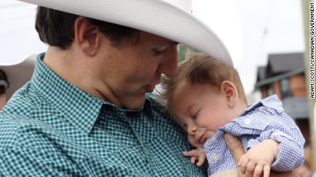Canadian Prime Minister Justin Trudeau holds his name sake Justin-Trudeau Adam Bilal while attending the Calgary Stampede on Saturday, July 15. The parents of the mini-Trudeau, Afraa Hajj Hammoud and Mohammed Belal, left Syria six years ago and settled in Canada in 2016.