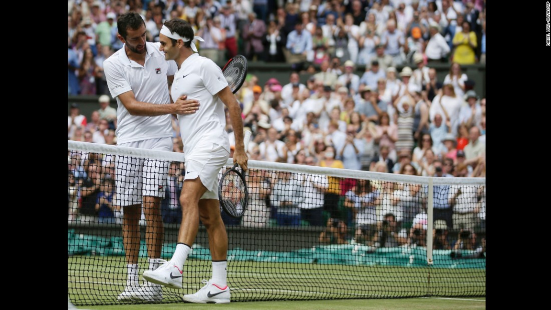 Marin Cilic congratulates Federer at the net after their match.