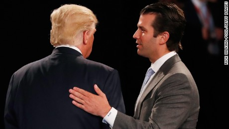 Donald Trump, Jr. (R) greets his father Republican presidential nominee Donald Trump during the town hall debate at Washington University on October 9, 2016 in St Louis, Missouri. This is the second of three presidential debates scheduled prior to the November 8th election.