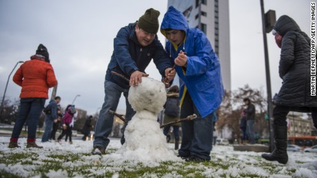 People make a snowman in Santiago on July 15, 2017. 