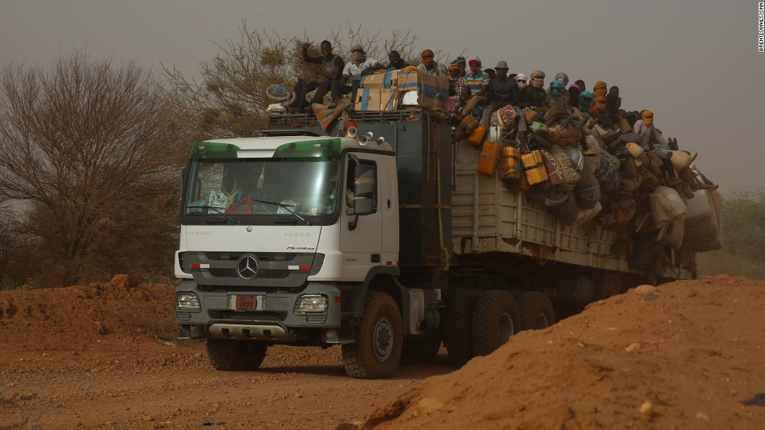 "Goods and people move along the ""national highway"" just outside Agadez."