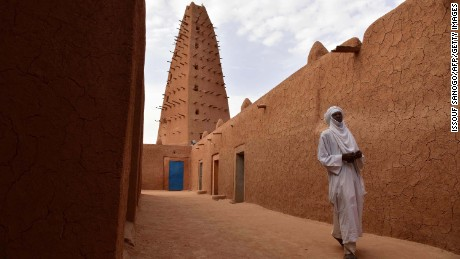 A man walks in the vicinity of a earthen mud mosque in Agadez, in northern Niger, on April 2, 2017.  / AFP PHOTO / ISSOUF SANOGO        (Photo credit should read ISSOUF SANOGO/AFP/Getty Images)