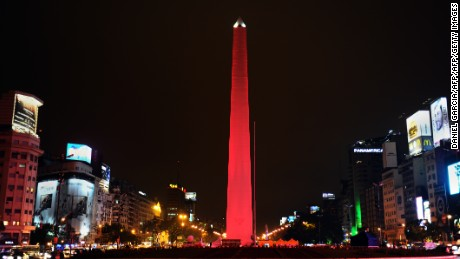 Buenos Aires landmark the Obelisk of 9 de Julio avenue, appears intermittently illuminated in red following the rhythm of sounds that reproduce heartbeat, in a theatrical campaign to prevent cardiovascular disease on September 5, 2012 in Buenos Aires.      AFP PHOTO / DANIEL GARCIA        (Photo credit should read DANIEL GARCIA/AFP/GettyImages)