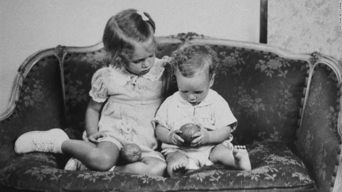 John S. McCain III, right, sits on a sofa with his sister, Sandy, in a reproduction of a family photo taken about 1938.