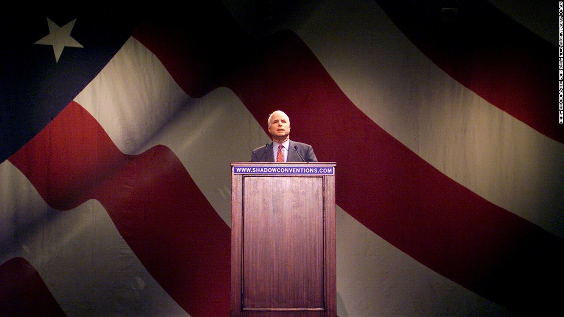 McCain addresses a shadow convention at the Annenberg Center of the University of Pennsylvania. McCain was booed when he asked supporters to back his primary opponent, George W. Bush, for president. The shadow convention was put on near the site of the Republican National Convention in Philadelphia to highlight issues that organizers said the major parties had ignored.