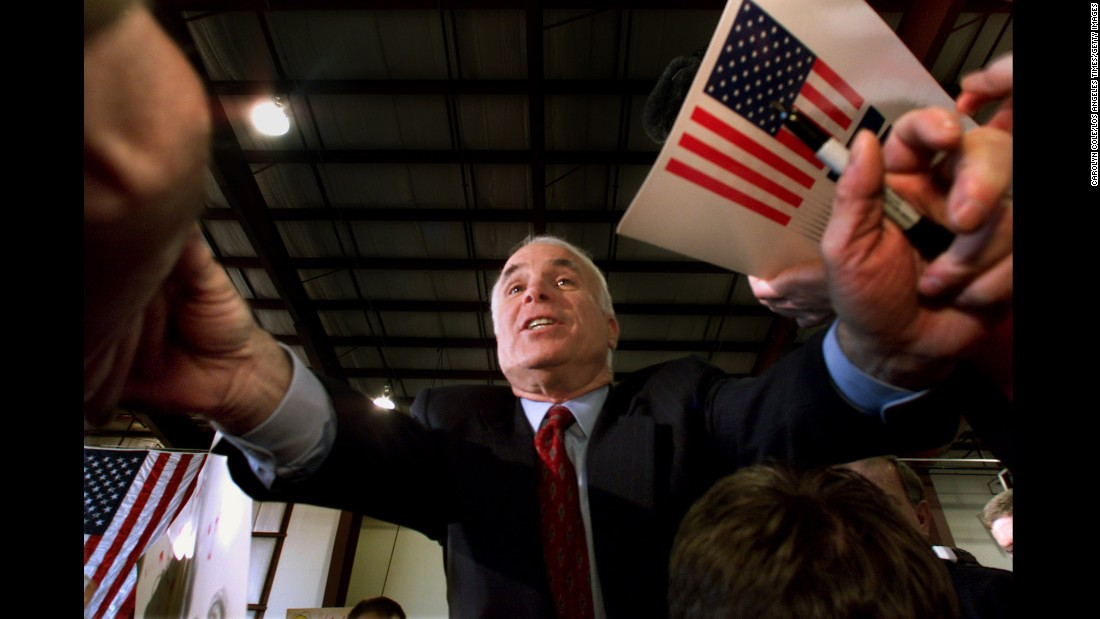 McCain reaches out to supporters on March 4, 2000, at a campaign rally in Portland, Maine.