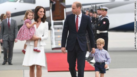 Britain's Prince William, Duke of Cambridge (R) and his wife Kate, Duchess of Cambridge (L) with their children Prince George and Princess Charlotte arrive at the airport in Warsaw, Poland, on July 17, 2017.