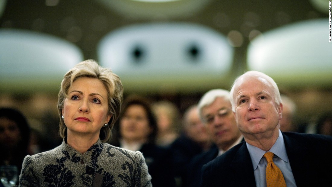 Clinton and McCain listen to President George W. Bush speak during the National Prayer Breakfast in 2007 in Washington.