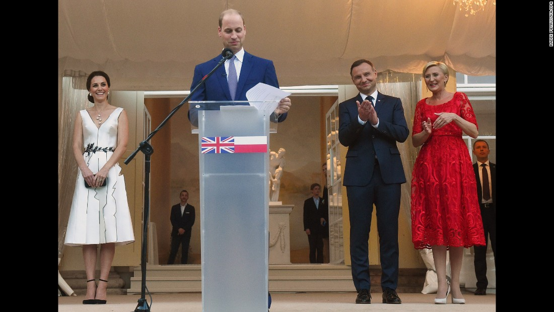 William speaks as Kate, left, and Polish President Andrzej Duda and his wife, Agata Kornhauser-Duda, listen during a Queen's birthday party on July 17, in the Orangery in Lazienki Park in Warsaw, Poland.