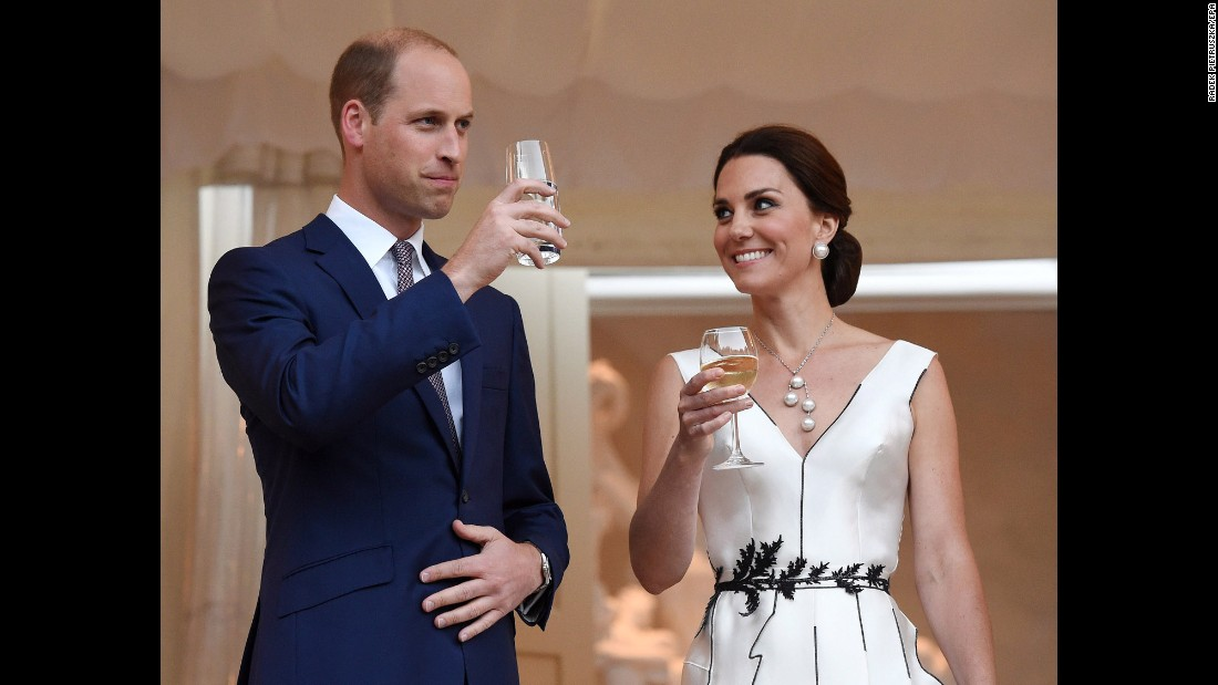 William and Kate make a toast during a Queen's birthday party in Poland.