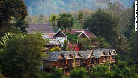 Few bungalows in the middle of the green jungle of Nong Kiau village in northern Laos, Southeast Asia.