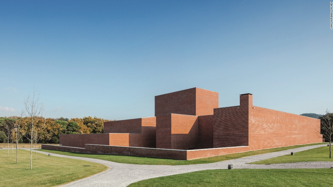 This red brick box theater in a small village just outside of Barcelona was commissioned as part of a public investment in cultural facilities. Designed by Portuguese architect Álvaro Siza, the seemingly windowless building consists of two parts: one containing a 300-seat auditorium and the other housing the theater's offices.