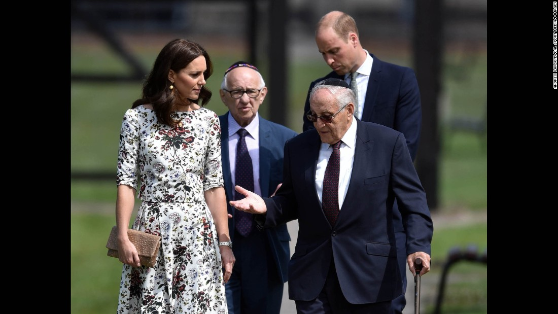Former Nazi concentration camp prisoners Manfred Goldberg, second from left, and Zigi Shipper speak with the royal couple during their visit to Stutthof, a World War II Nazi concentration camp in the village of Sztutowo, Poland.