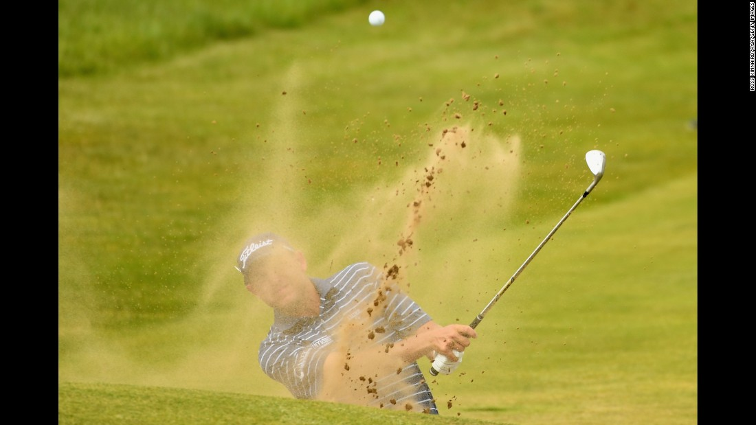 Bill Haas of the United States tied for ninth at last year's Open. He is pictured here hitting from a bunker during practice.