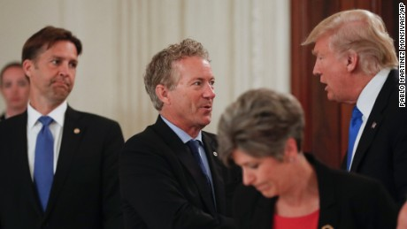 President Donald Trump stops to greet Sen. Rand Paul, R-Ky., center, and Sen. Ben Sasse, R-Neb. during a luncheon with GOP leadership, Wednesday, July 19, 2017, in the State Dinning Room of the White House in Washington. Sen. Joni Ernst, R-Iowa is in the foreground. (AP Photo/Pablo Martinez Monsivais)
