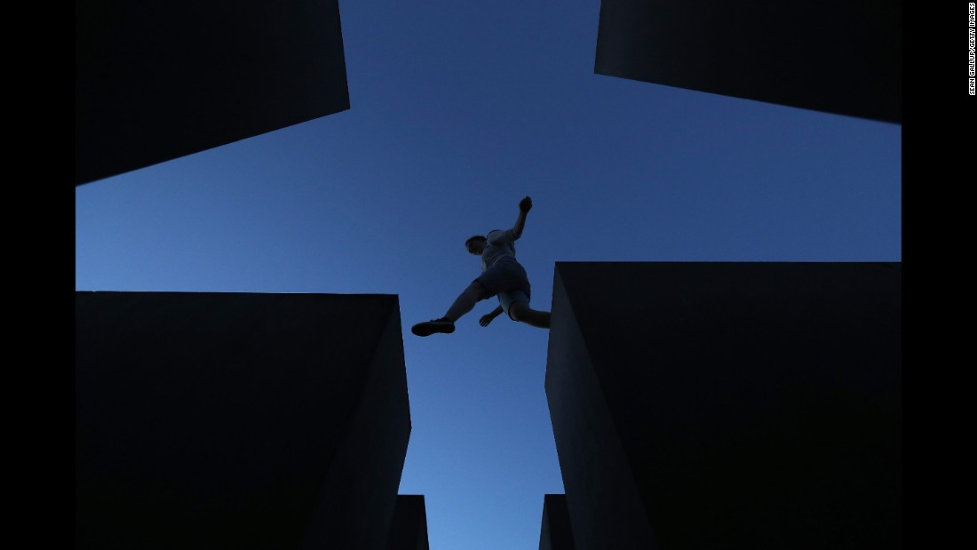 <strong>Berlin:</strong> A visitor leaps across some of the 2,711 concrete blocks that make up Berlin's Holocaust Memorial, designed by architect Peter Eisenman and engineer Buro Happold.