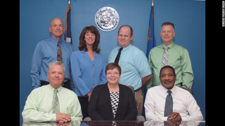 This file photo shows six current board members and retired commissioner Maurice Silva, lower left