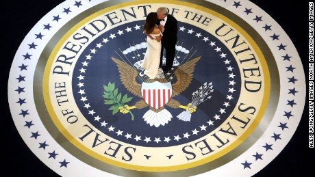 WASHINGTON, DC - JANUARY 20:  President Donald Trump and his wife First Lady Melania Trump kiss and dance on stage during A Salute To Our Armed Services Inaugural Ball at the National Building Museum on January 20, 2017 in Washington, DC. President Donald Trump was sworn in as the 45th President of the United States today.  (Photo by Alex Wong/Getty Images)