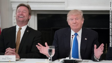President Donald Trump (R) delivers remarks on health care and Republicans' inability thus far to replace or repeal the Affordable Care Act, beside Sen. Dean Heller (R-NV) (L) during a lunch with members of Congress in the State Dining Room of the White House on July 19, 2017 in Washington, DC. (Photo by Michael Reynolds - Pool/Getty Images)