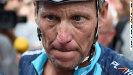 "US cyclist Lance Armstrong looks on upon his arrival in Rodez, southwest France, after riding a stage  of The Tour De France for a leukaemia charity, a day ahead of the competing riders, on July 16, 2015. For the first time since he was stripped of his seven Tour de France titles, disgraced cyclist Lance Armstrong rode a stage of the famous race for charity. Armstrong, 43, was riding a 198-kilometre (123-mile) stage a day ahead of the competing riders for a leukaemia charity but cycling officials have branded the exercise ""disrespectful"". AFP PHOTO / STEPHANE DE SAKUTIN        (Photo credit should read STEPHANE DE SAKUTIN/AFP/Getty Images)"
