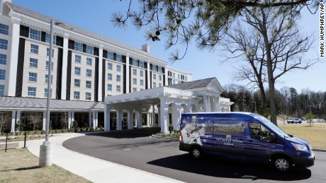 A tour bus leaves the Guest House at Graceland hotel on Thursday, March 2, 2017, in Memphis, Tenn. The $90 million, 450-room hotel that opened last year is part of a $140 million expansion at Graceland, Elvis Presley's longtime home. (AP Photo/Mark Humphrey)