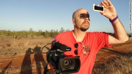 Filmmaker David Makepeace observing a total solar eclipse in Australia in November 2012.