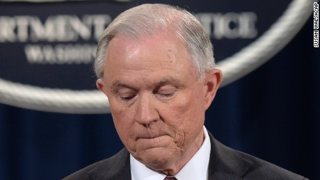 FILE - In this March 2, 2017 file photo, Attorney General Jeff Sessions pauses during a news conference at the Justice Department in Washington where he said he will recuse himself from a federal investigation into Russian interference in the 2016 White House election. The political cloud over Sessions' decision to step back from any investigation touching the Trump campaign may have a silver lining for a law enforcement officer who appears preoccupied by issues such as violent crime. Now that Sessions will no longer oversee any probe into the election, his path is cleared to more quickly refashion the Justice Department and chip away at key priorities of the Obama administration. (AP Photo/Susan Walsh, File)