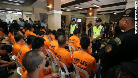 Suspects in a Philippines kidnap-for-ransom gang are paraded in front of the press in Manila on July 20, 2017.