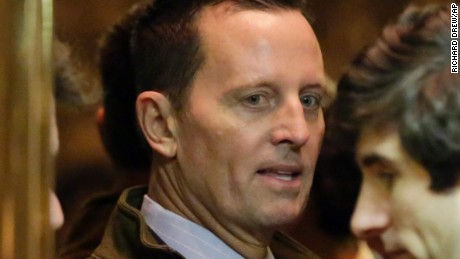 Richard Grenell, left, arrives in Trump Tower, in New York, Monday, Dec. 12, 2016. (AP Photo/Richard Drew)