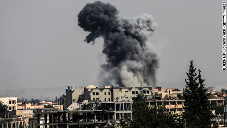 Heavy smoke billows following an airstrike on the western frontline of Raqa on July 17, 2017, during an offensive by the US-backed Syrian Democratic Forces, a majority Kurdish and Arab alliance, to retake the city from Islamic State (IS) group fighters. Heavy bombardment and fierce fighting shook the Islamic State group's Syrian stronghold Raqa, as SDF said they captured a new neighbourhood from entrenched jihadists. Bursts of gunfire and artillery as well as the thud of air strikes conducted by the US-led coalition filled the air in western neighbourhoods of Raqa, on what AFP's correspondent said was the heaviest day of bombardment to date.  / AFP PHOTO / BULENT KILIC        (Photo credit should read BULENT KILIC/AFP/Getty Images)