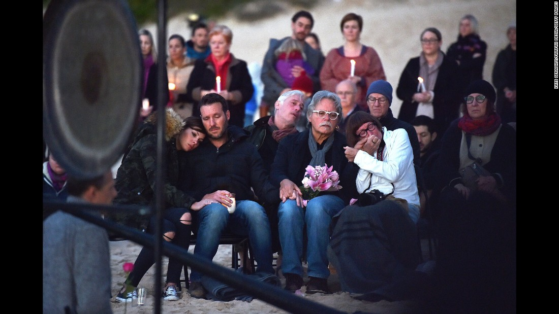 "Family members of Justine Ruszczyk attend a vigil for her at Freshwater Beach in Sydney on Wednesday, July 19. Ruszczyk, 40, was originally from Australia but moved to the United States in 2014. She was killed by a police officer in Minneapolis minutes after calling 911 to report a possible sexual assault. The Ruszczyk family's attorney is <a href=""http://www.cnn.com/2017/07/20/us/minneapolis-australian-woman-killed-by-police/index.html"" target=""_blank"">calling for a comprehensive investigation and policy review</a>."