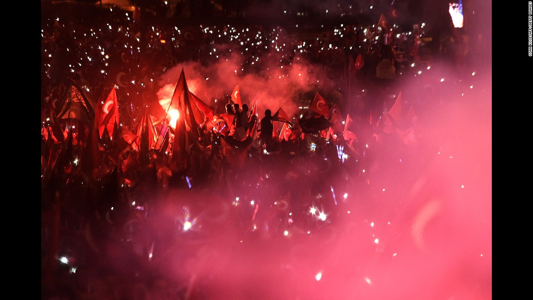 "People wave Turkish flags during a speech by President Recep Tayyip Erdogan in Istanbul on Saturday, July 15, marking the first anniversary of a failed coup. <a href=""http://www.cnn.com/2017/07/14/europe/turkey-coup-attempt-anniversary/index.html"" target=""_blank"">Fear and optimism in Turkey one year after failed coup</a>"