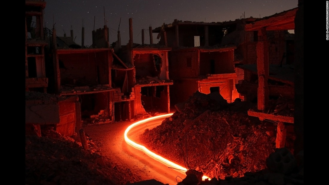 Damaged buildings are seen at night in the rebel-held area of Daraa, Syria, on Saturday, July 15. This picture was made using a long exposure.